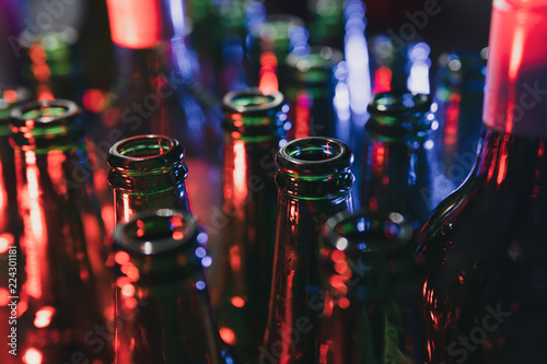 Fotografía  Stop drinking concept: Empty glass bottles on blurred background.