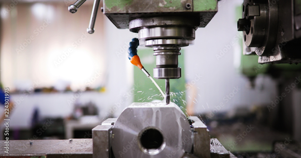 Fototapeta machine tool in metal factory with drilling cnc machines