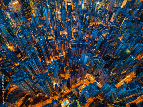 Fototapeten New York Aerial view of Hong Kong Downtown. Financial district and business centers in smart city, technology concept. Top view of skyscraper and high-rise buildings at night.