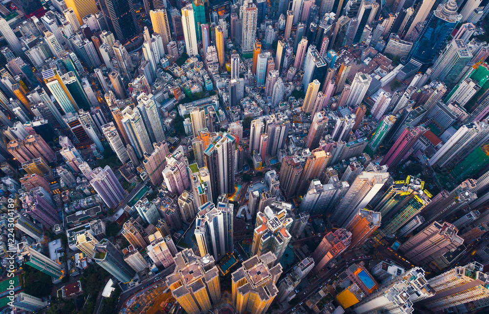 Fototapeta Aerial view of Hong Kong Downtown. Financial district and business centers in smart city in Asia. Top view of skyscraper and high-rise buildings.
