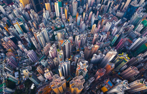 Spoed Foto op Canvas New York Aerial view of Hong Kong Downtown. Financial district and business centers in smart city in Asia. Top view of skyscraper and high-rise buildings.