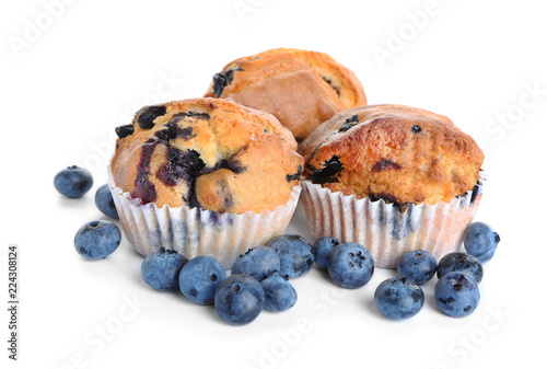 Valokuva Tasty blueberry muffins on white background