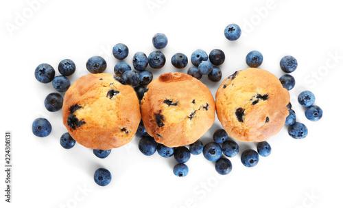 Carta da parati Tasty blueberry muffins on white background