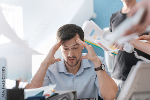 Fototapeta Stressed businessman with a lot of work in office obraz