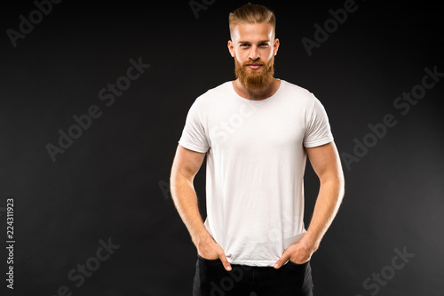 Fotografia  Handsome young guy posing in studio - isolated.
