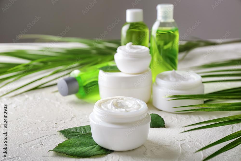 Fototapeta Jar with body cream on white table