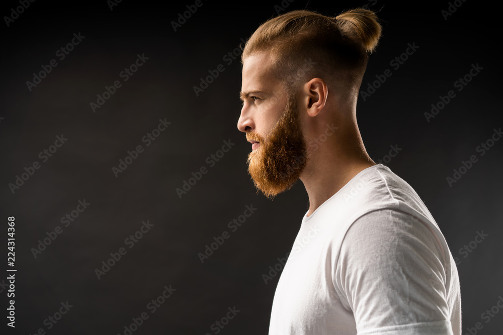 Fototapeta Side view portrait of thinking stylish young man looking away.