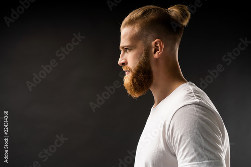 Fototapeta Side view portrait of thinking stylish young man looking away. obraz