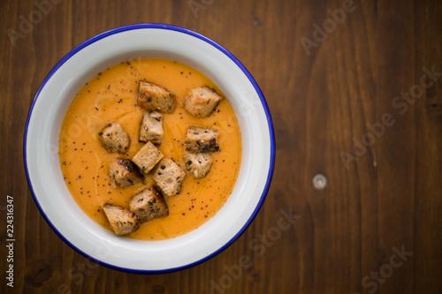 Fotografie, Obraz  Orange creamy soup with croutons