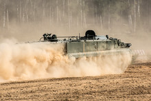 The Front Of The Tank, Riding Through The Dust.