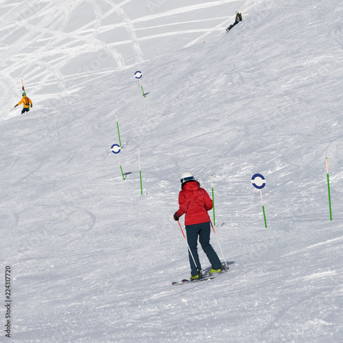 Skier and snowboarders downhill