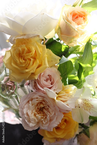 Fotobehang Bloemen bouquet of roses wite and yellow on the sun