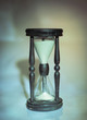 hourglass on dark background.the concept of time