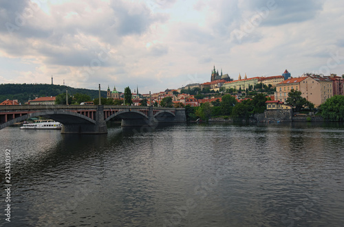 Fotografie, Obraz  Scenic view of historical center of Prague, Manes Bridge and Vltava river at cloudy summer day