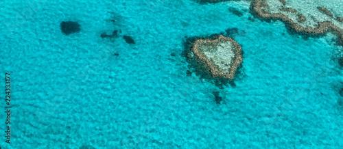 Aerial overhead view of Heart Island - Coral Reef, Australia