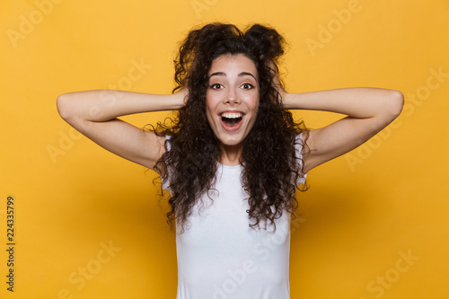 Fototapeta Shocked excited young cute woman posing isolated over yellow background. obraz na płótnie