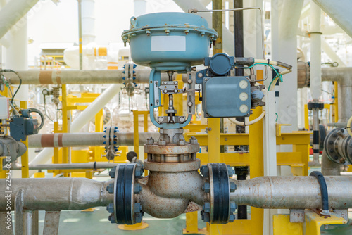 Fotografie, Tablou Actuated control valve fail to open type and valve positioner control by programmable logic controller (PLC) to control oil and gas conditioning process