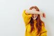 Leinwandbild Motiv laughing woman covering her eyes with her arm