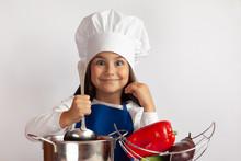 Cute Girl In Chef Uniform Cook...
