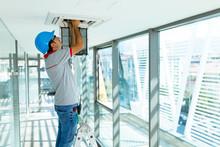 Worker Installing Air Conditioner