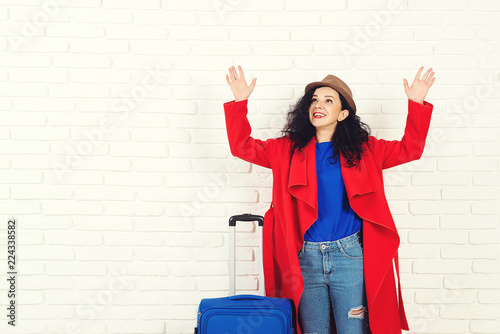 Fotografija  Surprising girl before traveling