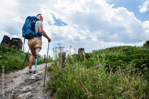 Fotografia  Joyful young man trying up Nordic walking
