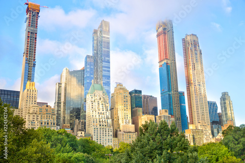 Growing skyscrapers at Central Park in midtown Manhattan, New York Poster Mural XXL