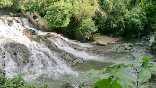 Foto op Plexiglas Watervallen Waterfall in green rainforest. waterfall in the mountain jungle. Bali,Indonesia. Travel concept.