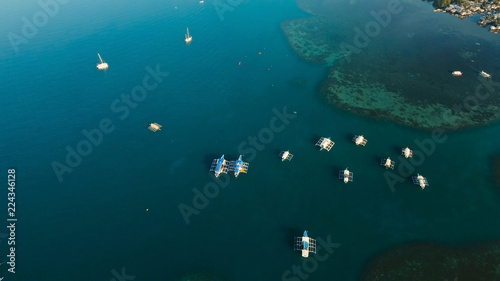 Aerial view of sailing boats and yachts in the bay. Boat and yacht in the tropical lagoon. Aerial view: tropical landscape. Tropical island. Philippines, El Nido. Travel concept
