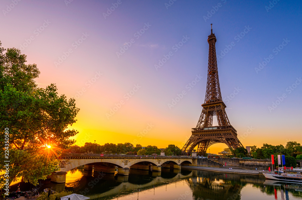Fototapeta View of Eiffel Tower and river Seine at sunrise in Paris, France. Eiffel Tower is one of the most iconic landmarks of Paris
