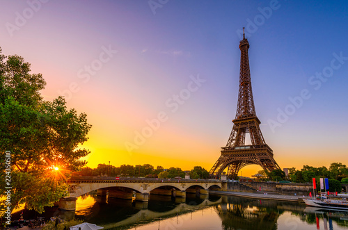 Poster Centraal Europa View of Eiffel Tower and river Seine at sunrise in Paris, France. Eiffel Tower is one of the most iconic landmarks of Paris