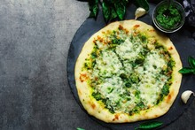 Homemade Pesto Pizza With White Sauce Overhead View