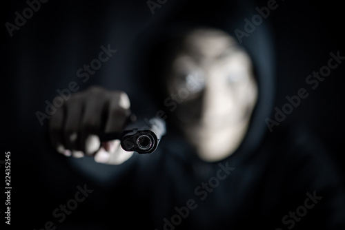 Hoodie Killer Man Wearing Mystery Mask Holding Gun Anonymous Thief Or Burglar Committing The Crime