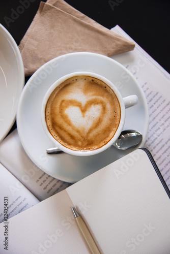 Fotografie, Obraz  Magazine with latte art cappuccino. Top view shot.