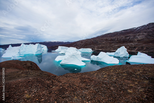 Fotobehang Poolcirkel massive Icebergs floating in the fjord scoresby sund, east Greenland
