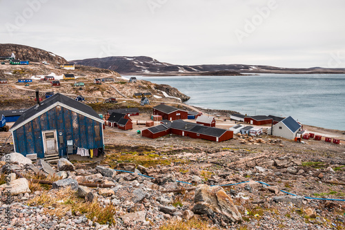 settlement of Ittoqqortoormiit with colorful houses, eastern Greenland at the entrance to the Scoresby Sound fjords