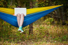 Photo Of Woman Resting In Hammock With Laptop In Forest