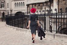 Parisian Woman In Red Hat Walking Alone In Montmartre District