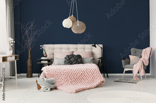 King-size bed with soft bedhead, knot grey cushion and ...