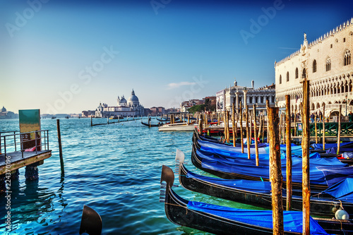 Photo sur Toile Venise World famous gondolas in Venice lagoon