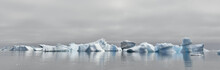 Iceberg Floating In The Water Off The Coast Of Greenland. Nature And Landscapes Of Greenland.