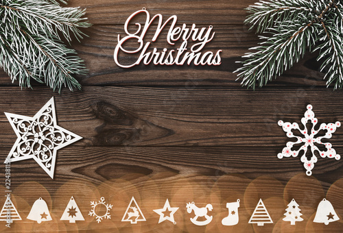 Fotografie, Obraz  View from above of a Merry Christmas inscription and handmade tree toys, stars a