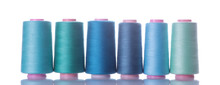 A Bobbin With Threads In Blue Tones On A White Isolated Background. Accessories For Sewing