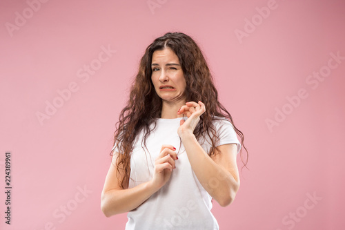 Obraz Ew. It's so gross. Young woman with disgusted expression repulsing something. Disgust concept. Young emotional woman. Human emotions, facial expression concept. Studio. Isolated on trendy pink color - fototapety do salonu