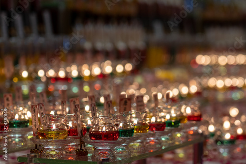 Photo  Candles Lit during a ceremony inside the Tooth Relic temple in Singapore