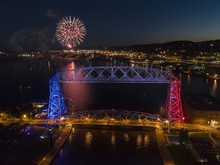 Fireworks In Duluth, Minnesota Seen From Above With The Aerial Lift Bridge In The Foreground