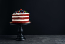 Stand With Delicious Homemade Red Velvet Cake And Space For Text On Black Background