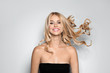 Leinwanddruck Bild - Beautiful woman with healthy long blonde hair on light background