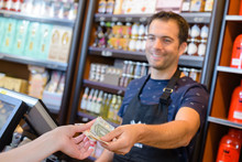 Cashier Taking Money