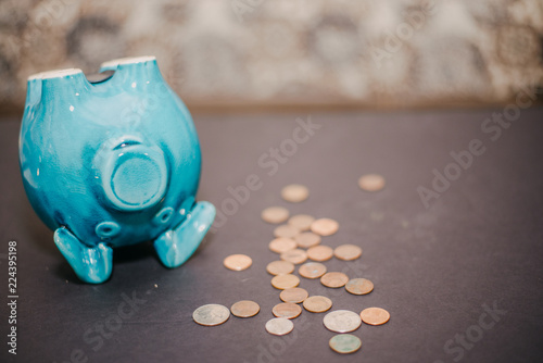 Photo  Piggy Bank with coins laying next to it